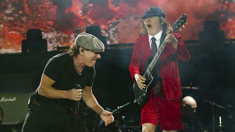 Leadzanger Brian Johnson en leadgitarist Angus Young. Beeld ANP