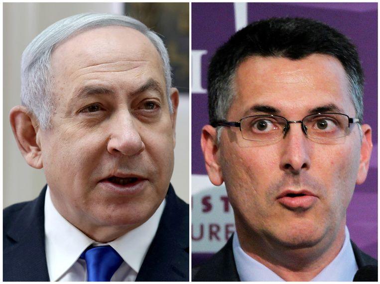 Netanyahu (links) en zijn tegenstander en partijgenoot Gideon Sa'ar. Beeld REUTERS