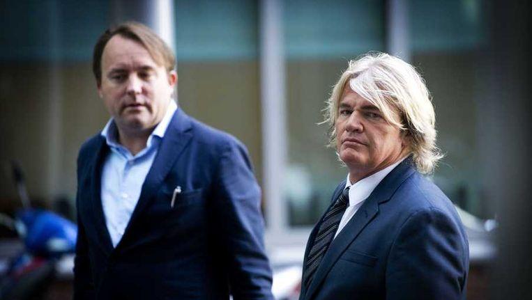 Rob Bolland (R) en zijn advocaat Geertjan van Oosten bij de rechtbank van Haarlem Beeld anp