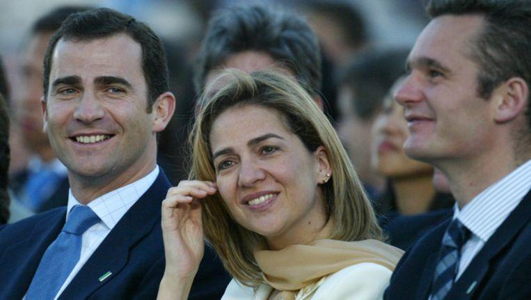 De Spaanse prinses Cristina en haar echtgenoot Inaki Urdangarin (rechts). Beeld afp