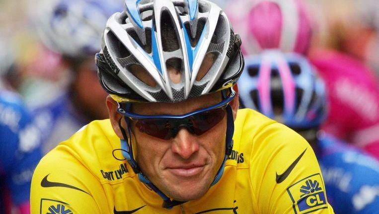 Lance Armstrong in een van zijn gele truien. Beeld afp