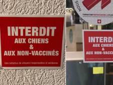 """""""Interdit aux chiens et aux non-vaccinés"""": des affiches contre le pass sanitaire sur des magasins à Genève"""