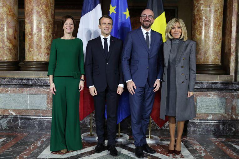 Premier Charles Michel en zijn partner Amélie ontvangen de president en zijn vrouw in het Egmontpaleis.  Beeld AP