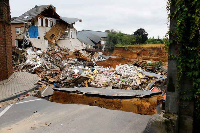 Vernielde huizen in Erftstadt-Blessem.  Beeld REUTERS