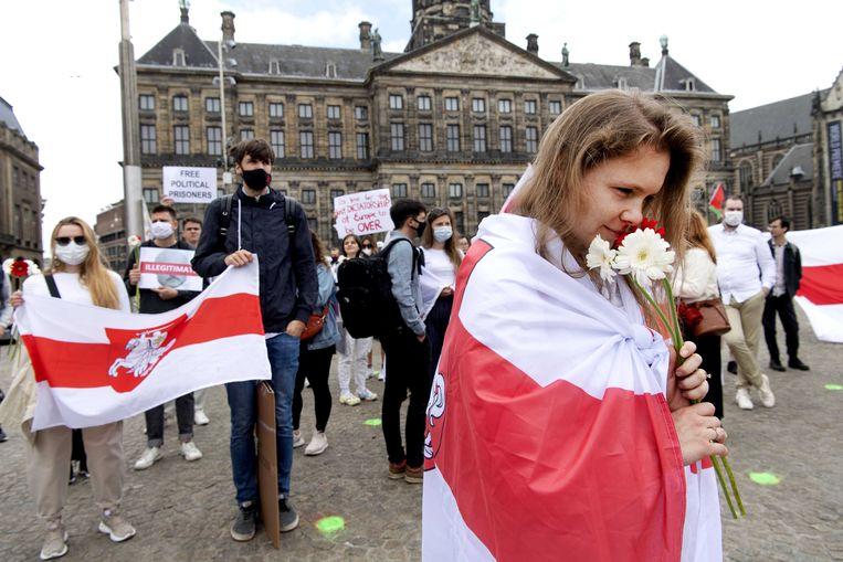 Een demonstratie in Amsterdam tegen het beleid van president Aleksandr Loekasjenko in Belarus.  Beeld ANP