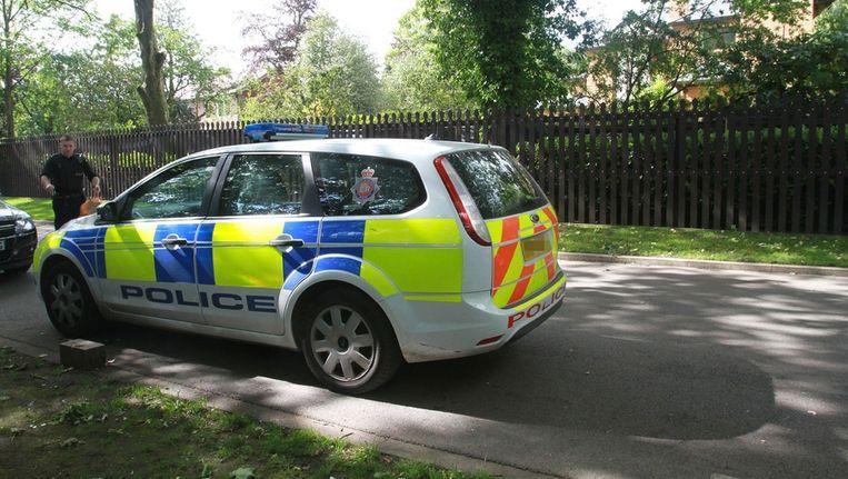 Politiewagen voor het huis van profvoetballer Ryan Giggs. FOTO'S BRUNOPRESS Beeld