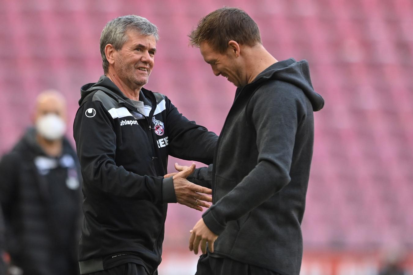 FC Köln-trainer Friedhelm Funkel (l) met RB Leipzig-trainer Julian Nagelsmann.