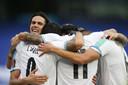 De spelers van Uruguay vieren een doelpunt van Suárez.