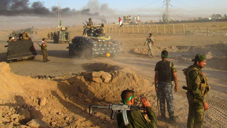 Iraakse soldaten bij de belegering van Fallujah. Beeld AP