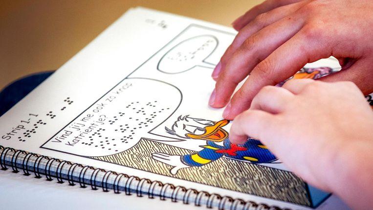 Blinde kinderen kunnen straks ook de Donald Duck lezen Beeld ANP