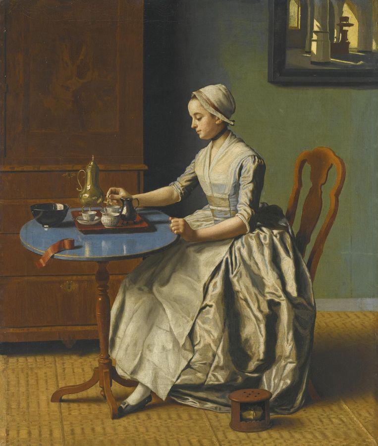 Hollands meisje aan het ontbijt. Beeld