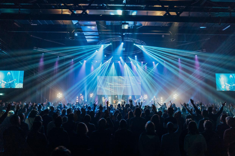 Een bijeenkomst van Mozaiek0318 in een theaterzaal met plek voor 1400 personen.