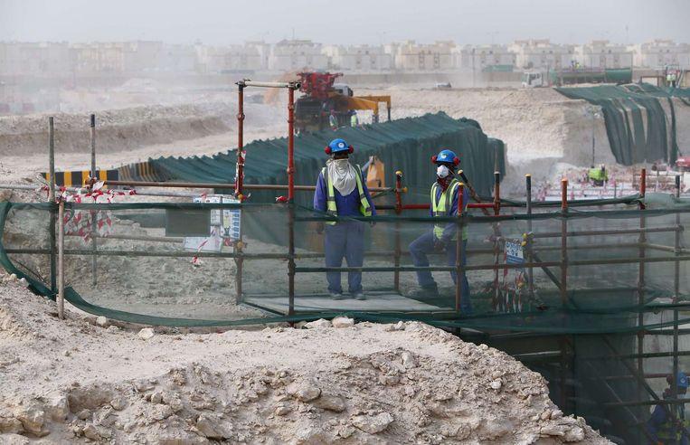Rapporten maken melding van erbarmelijke leef- en werkomstandigheden voor de arbeiders. Beeld AFP