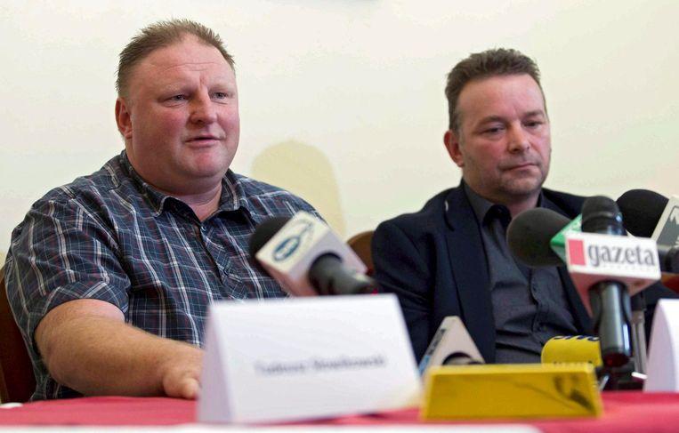 Piotr Koper en Andreas Richter tijdens een persconferentie vorig jaar over de nazitrein. Beeld AFP
