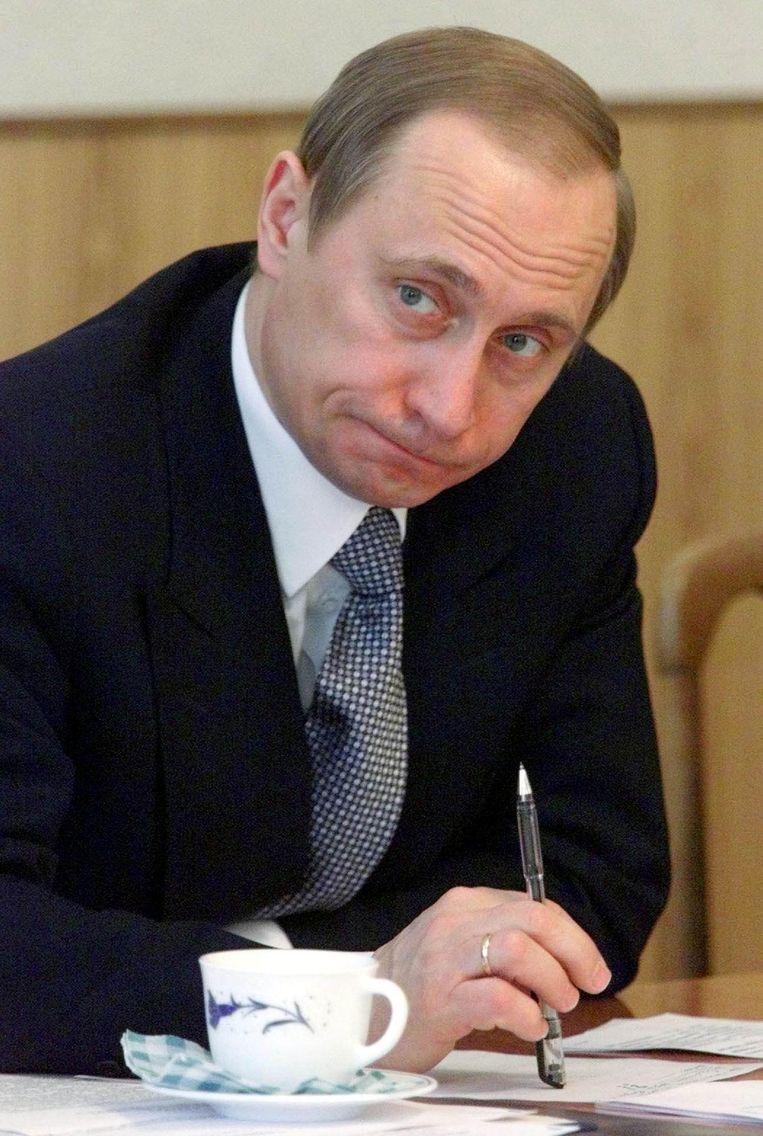 Poetin in 2000. Beeld afp