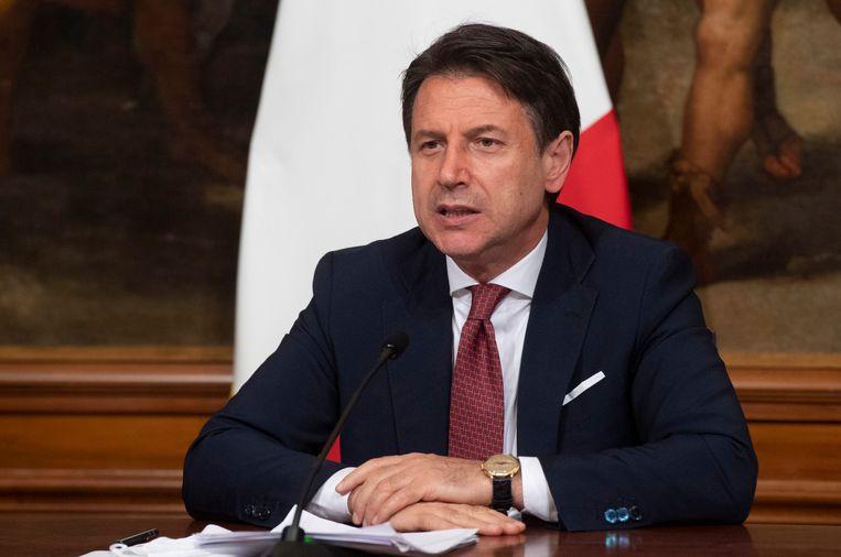 De Italiaanse premier Giuseppe Conte, tijdens de persconferentie over het economische relanceplan. (07/08/2020) Beeld EPA