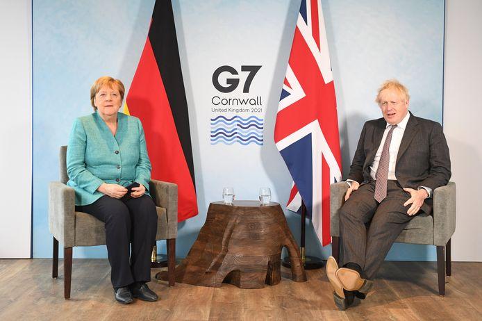 De Britse premier Boris Johnson met Duits bondskanselier Angela Merkel.