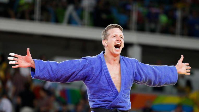 Vreugde bij Dirk Van Tichelt na zijn winnende kamp om brons. Beeld ap