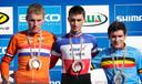 Winnaar Julian Alaphilippe en Mike Teunissen (tweede) na de wereldbekerwedstrijd veldrijden in Rome op 6 januari 2013. De Belg Gianni Vermeersch maakt het podium compleet.