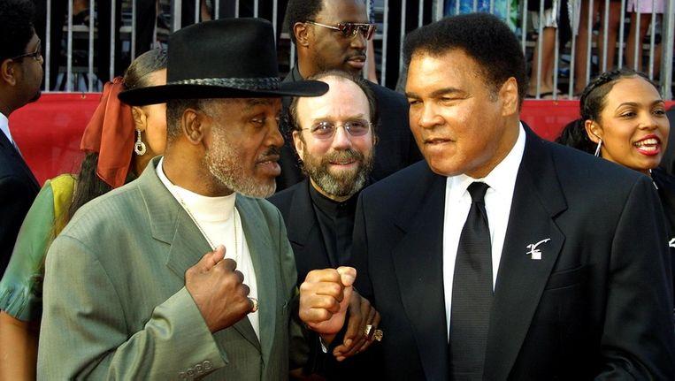 Mohammed Ali (rechts) en Joe Frazier. Beeld bruno
