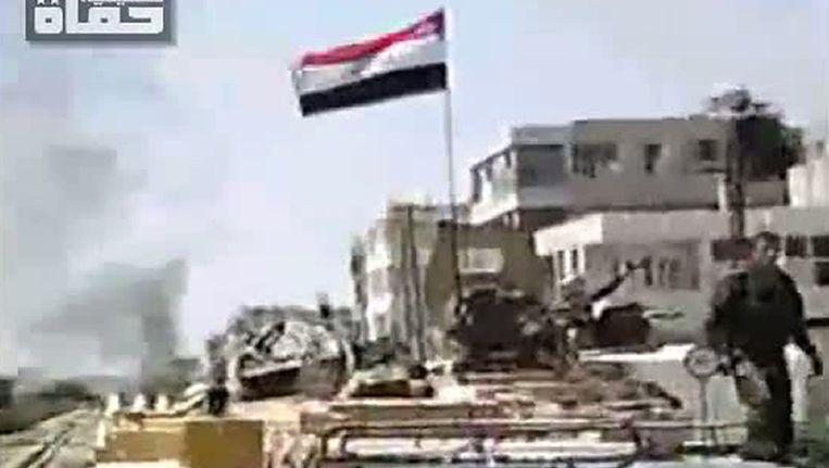 Syrische veiligheidstroepen in Hama. Beeld afp