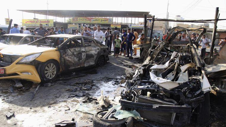 In de stad Karbala nabij Bagdad ontploften gister twee autobommen Beeld reuters