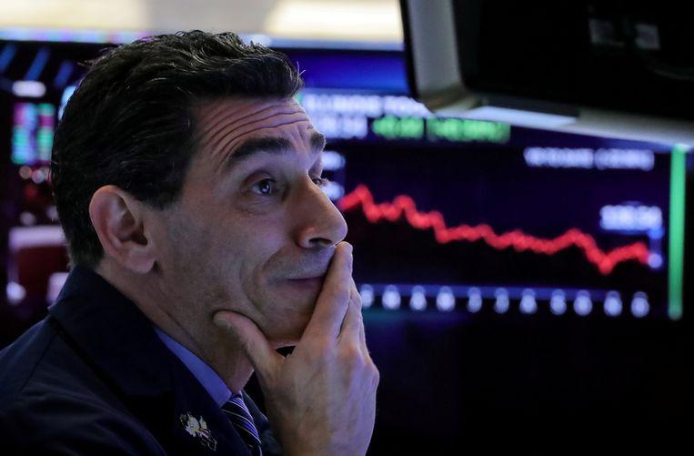 Bedenkelijke blikken op de handelsvloer van de New York Stock Exchange Beeld REUTERS