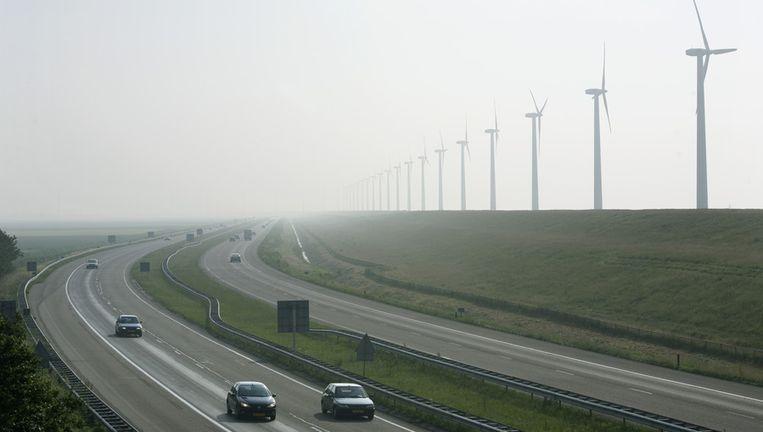 Het Vorrink windmolenpark langs de IJsselmeerdijk bij Lelystad, Flevoland. Beeld anp