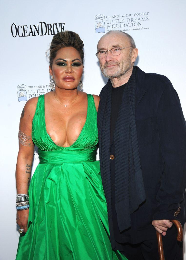 Orianne Cevey en Phil Collins. Beeld Getty Images