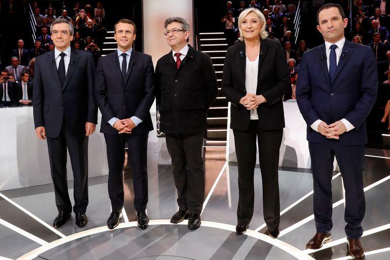 De deelnemers aan het debat van links naar rechts: Francois Fillon, Emmanuel Macron, Jean-Luc Mélenchon, Marine Le Pen en Benoît Hamon. Beeld AP