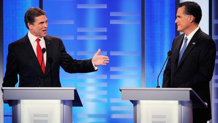 Rick Perry en Mitt Romney. Beeld AFP
