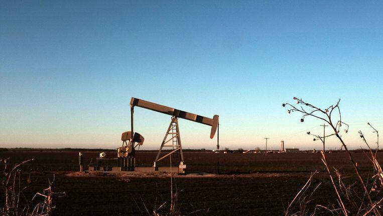 De extreem lage olieprijs blijft de markten onder druk zetten. Beeld AFP