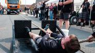 VIDEO. Waar al die uren in de fitness goed voor zijn? Om vrachtwagens door de straat te kunnen sleuren, tiens!