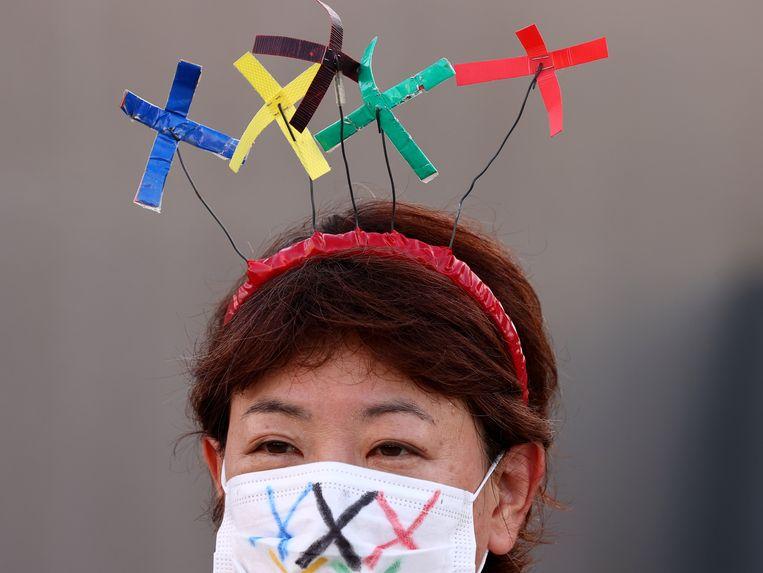 Protest tegen de Spelen in Tokio deze week. Beeld REUTERS