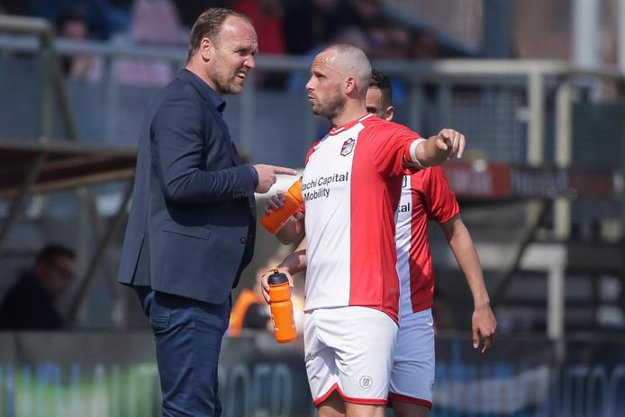Trainer Dick Lukkien met zijn aanvoerder Anco Jansen.