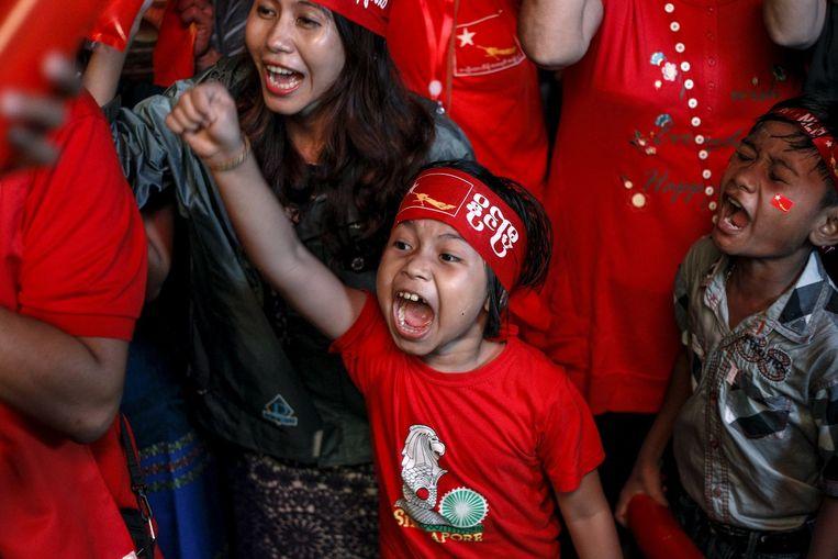 Een jonge aanhanger van de NLD. Beeld reuters