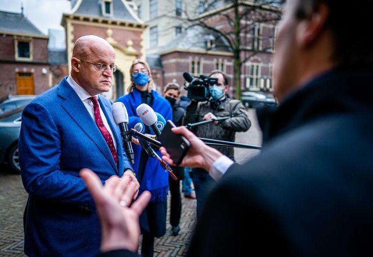 Minister Grapperhaus staat de pers te woord. Beeld ANP