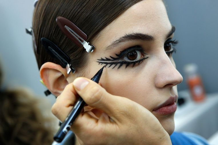 A model is made up backstage prior to the Christian Dior Haute Couture Spring-Summer 2018 fashion collection presented in Paris, Monday, Jan. 22, 2018. (AP Photo/Francois Mori)