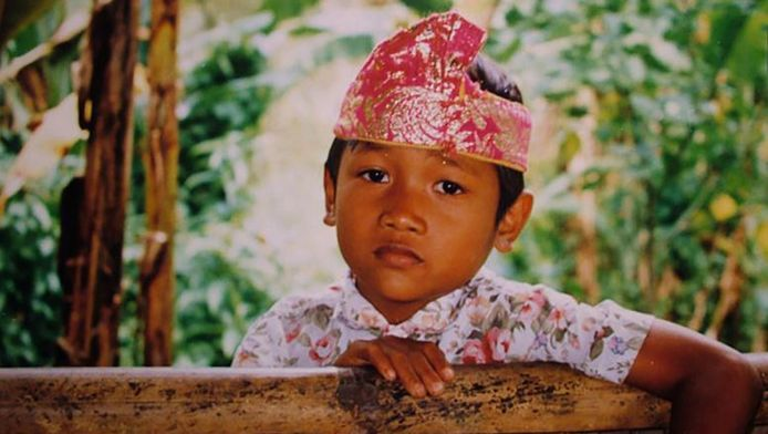Een jongetje in een weeshuis op Java.