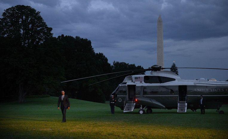 Obama landt met de helikopter aan het Witte Huis. Beeld PHOTO_NEWS