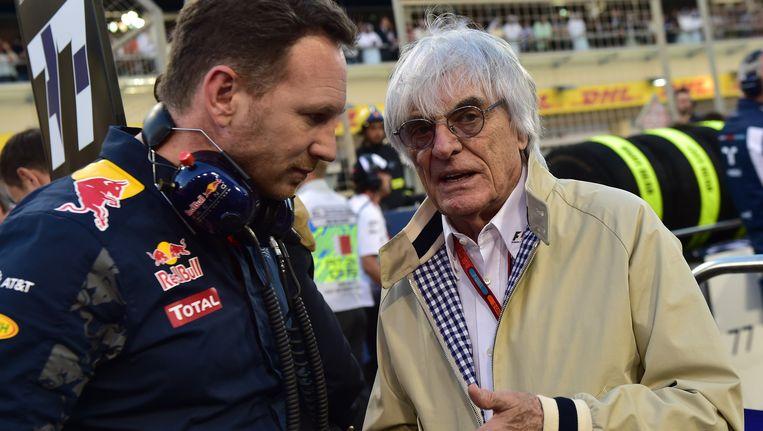 Formule 1-Baas Bernie Ecclestone (r.) met Red Bull-teambaas Christian Horner. Beeld AFP