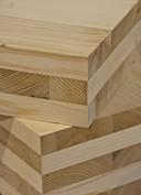 Cross Laminated Timberg, kruislings verlijmd hout,  door FAAM Architects gebruikt voor de bouw van woningen en appartementen in Eindhoven. Hiervan worden balken en platen gemaakt voor de constructie, (dragende) wanden en vloeren.