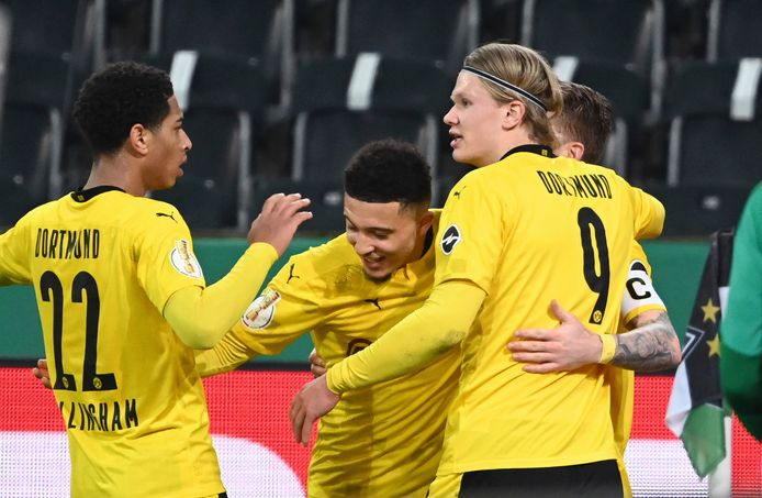 Dortmund's Jadon Sancho center, celebrates with teammates after scoring during the German Soccer Cup quarter final match between Borussia Moenchengladbach and Borussia Dortmund at Borussia Park, Moenchengladbach, Germany, Tuesday, March 2, 2021. (Federico Gambarini/Pool photo via AP)