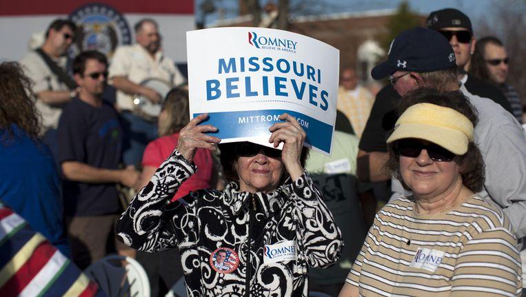 Romney-aanhangers gisteren bij een campagnebijeenkomst in de staat Missouri. Beeld ap