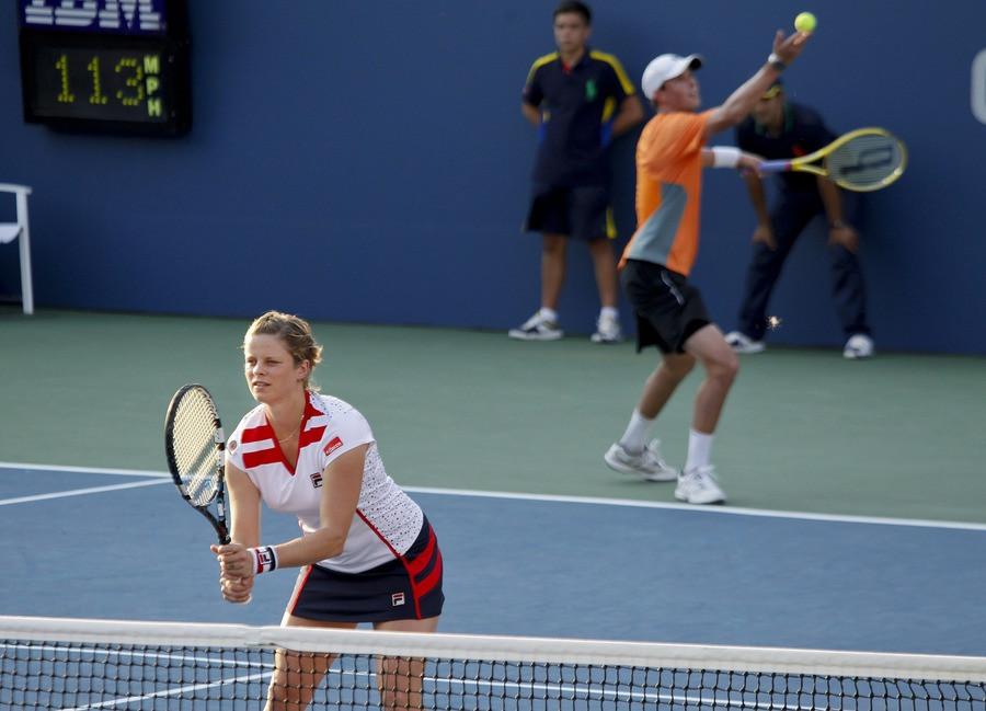 Kim Clijsters en Bob Bryan in actie op de US Open.