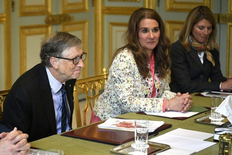Het Gates-koppel in 2018, op bezoek bij de Franse president. Beeld REUTERS