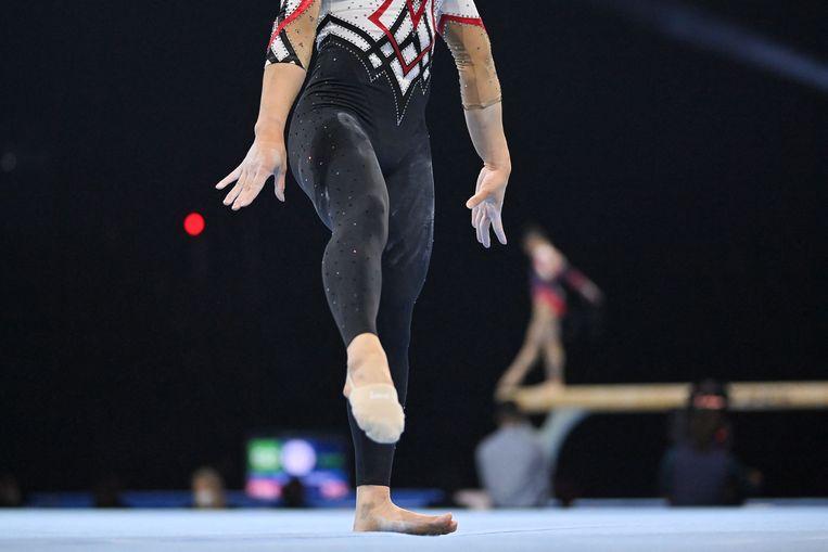 De Duitse Kim Bui turnt op de EK in Bazel in een legging,  een revolutie in die sport. Beeld AFP
