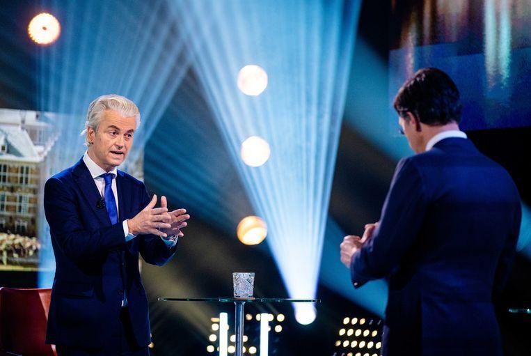 Lijsttrekkers Geert Wilders (PVV) en Mark Rutte (VVD) gaan vanuit de Melkweg met elkaar in debat tijdens de eerste uitzending van 'Pauws verkiezingsdebatten'. Beeld ANP