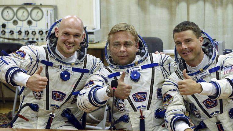 Alexander Gerst, Maxim Suraev en Reid Wiseman. Beeld ap