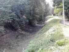 Asbest, ijzer en olie; resten oude vuilnisbelt zijn lastig bij het herstel van de binnengracht van Zaltbommel